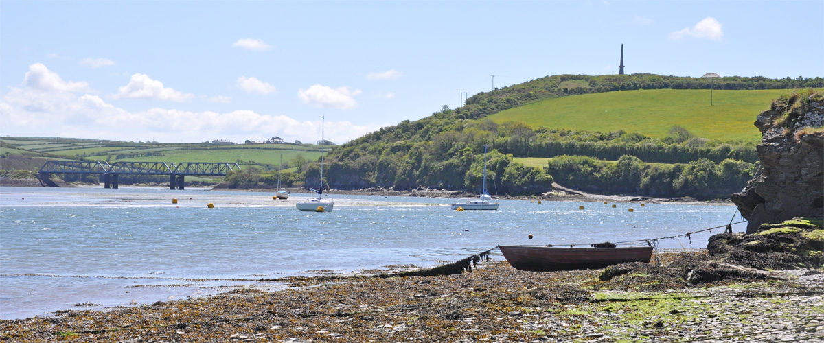 ..the foreshore at Padstow looking back at the former railway bridge and Queen Victoria monument..